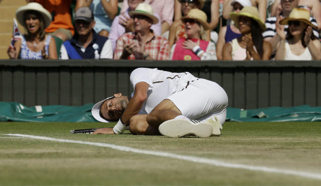 Serbia's Novak Djokovic on the floor in his match against Great Britain's Andy Murray in their Men's Final during day thirteen of the Wimbledon Championships at The All England Lawn Tennis and Croquet Club, Wimbledon.