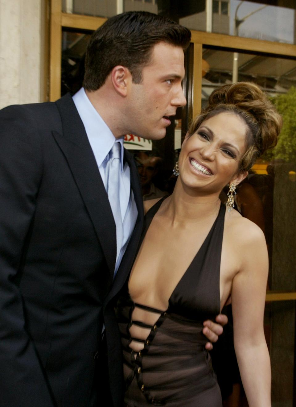 Actress Jennifer Lopez and fiance, actor Ben Affleck, pose for photographers as they arrive for the premiere of their new film