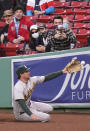 Oakland Athletics right fielder Stephen Piscotty dives but can't make the play on a double by Boston Red Sox's Marwin Gonzalez during the first inning of a baseball game, Wednesday, May 12, 2021, in Boston. (AP Photo/Charles Krupa)