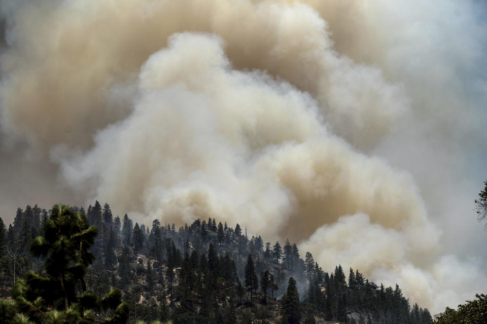 Smoke rises from the Dixie Fire burning along Highway 70 in Plumas National Forest, California, on July 16, 2021. / Credit: Noah Berger/AP