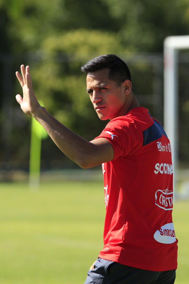 Chile's national team player Alexis Sanchez waves during a training session at Toca da Raposa 2, in Belo Horizonte, Brazil, Monday, June 9, 2014. Chile will play in group B of the Brazil 2014 World Cup. (AP Photo/Bruno Magalhaes)