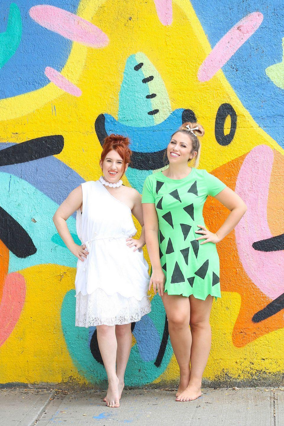 """<p>Have a <em>yabba dabba doo</em> time with your bestie as the female Flintstones.</p><p><strong>Get the tutorial at <a href=""""http://livingaftermidnite.com/2017/09/affordable-halloween-costumes-for-you-your-best-friend.html"""" rel=""""nofollow noopener"""" target=""""_blank"""" data-ylk=""""slk:Living After Midnite"""" class=""""link rapid-noclick-resp"""">Living After Midnite</a>.</strong></p><p><strong><a class=""""link rapid-noclick-resp"""" href=""""https://www.amazon.com/HDE-Womens-Shoulder-Cocktail-Ruched/dp/B01I27U8FE/?tag=syn-yahoo-20&ascsubtag=%5Bartid%7C10050.g.21349110%5Bsrc%7Cyahoo-us"""" rel=""""nofollow noopener"""" target=""""_blank"""" data-ylk=""""slk:SHOP WHITE DRESS"""">SHOP WHITE DRESS</a></strong></p>"""