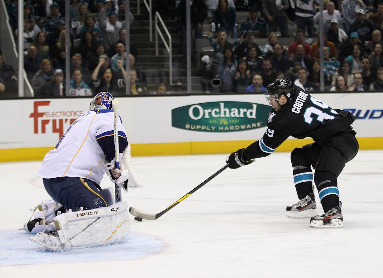 SAN JOSE, CA - APRIL 19:  Brian Elliott #1 of the St. Louis Blues stops Logan Couture #39 of the San Jose Sharks from scoring in the first period of Game Four of the Western Conference Quarterfinals during the 2012 NHL Stanley Cup Playoffs at HP Pavilion on April 19, 2012 in San Jose, California.  (Photo by Ezra Shaw/Getty Images)
