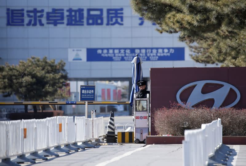 A security guard is seen at the main entrance of a plant of Hyundai Motor Co on the outskirts of Beijing