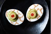 """<p>Setting your sights on a fright-filled party spread? Make sure these creepy peepers are included.</p><p><strong><em><a href=""""https://www.womansday.com/food-recipes/food-drinks/recipes/a11861/guacamoldy-eyeballs-recipe-123432/"""" rel=""""nofollow noopener"""" target=""""_blank"""" data-ylk=""""slk:Get the Guacamoldy Eyeballs recipe."""" class=""""link rapid-noclick-resp"""">Get the Guacamoldy Eyeballs recipe. </a></em></strong></p>"""
