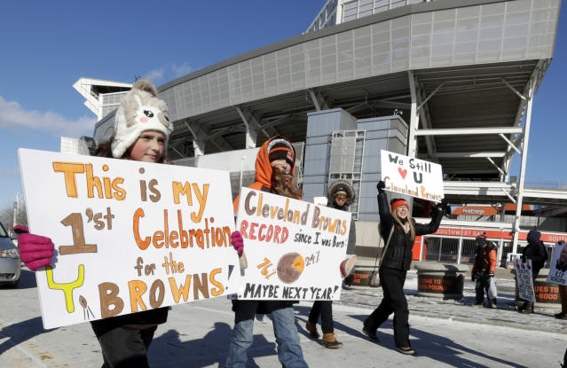 "Browns fans gathered for the ""perfect season"" parade on Saturday, but also managed to raise more than $17,000 for a local food bank. (AP Photo)"