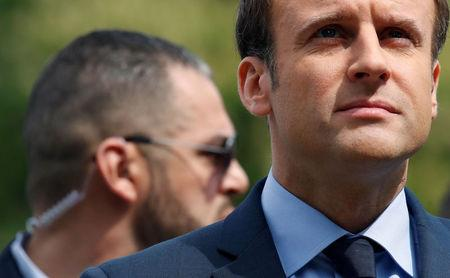 A body guard stands near Emmanuel Macron, head of the political movement En Marche !, or Onwards !, and candidate for the 2017 French presidential election, attends a ceremony in Paris