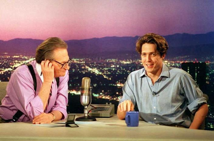 """<div class=""""inline-image__caption""""><p>Actor Hugh Grant talks to Larry King on """"Larry King Live"""" in July 1995. </p></div> <div class=""""inline-image__credit"""">AFP via Getty Images</div>"""