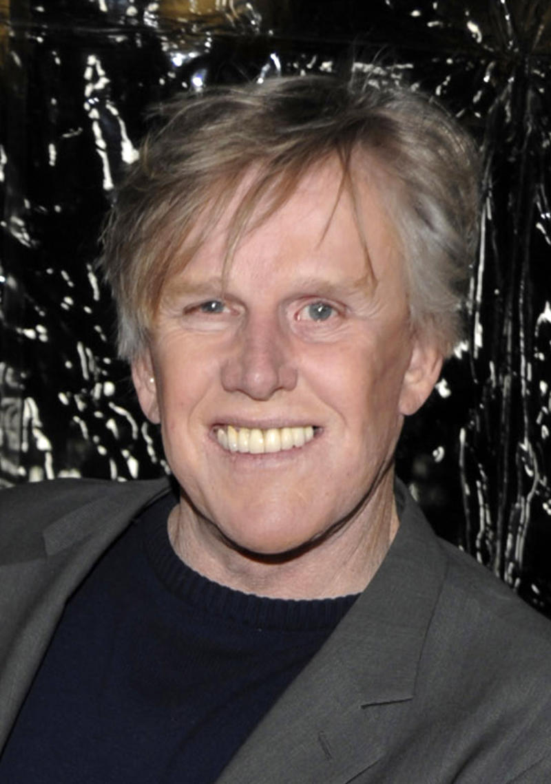 """FILE - In this Dec. 8, 2009 file photo, actor Gary Busey arrives at the premiere of the feature film """"Crazy Heart"""" in Beverly Hills, Calif.  Busey will make his New York stage debut next month in the off-Broadway show """"Perfect Crime,"""" playing a serial killer in the cast of the longest-running play in city history. He will play Lionel McAuley, a charismatic serial killer starting Nov. 21, 2016 at The Theater Center near Times Square. (AP Photo/Dan Steinberg, file)"""