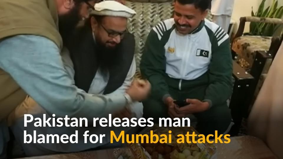 A firebrand Pakistani Islamist accused of masterminding a bloody 2008 assault in the Indian city of Mumbai was released from house arrest on Friday and told his cheering supporters his freedom was proof of his denial of guilt.