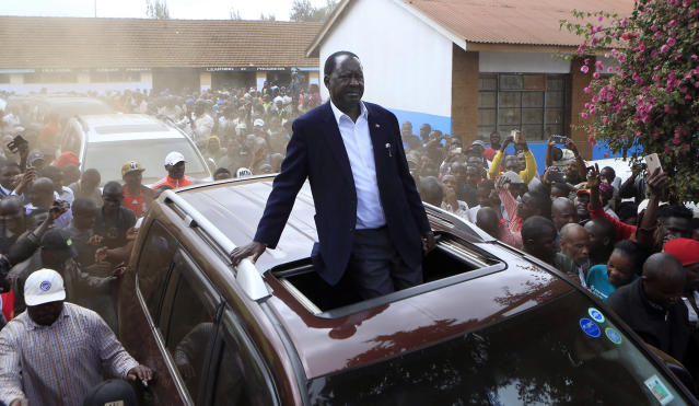 <p>Kenyan Opposition leader Raila Odinga drives passing his supporters after casting his vote in Kibera slums in Nairobi,Kenya, Tuesday, Aug. 8, 2017. (Photo: Noor Khamis/AP) </p>