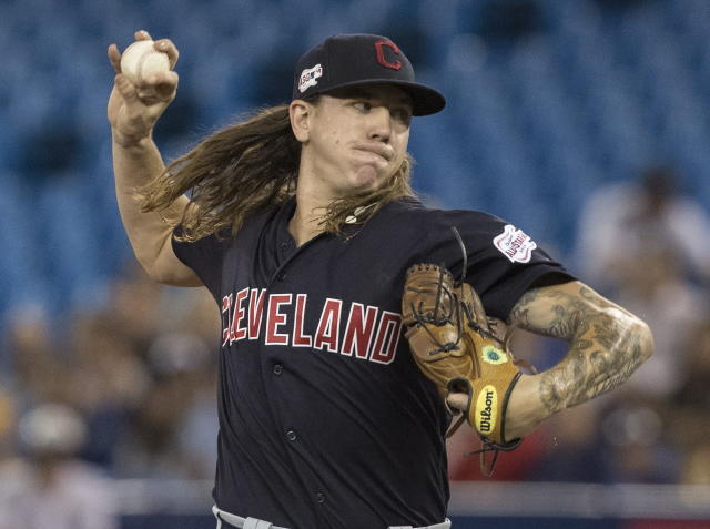 CORRECTS TO MIKE CLEVINGER NOT MIKEL CLEVINGER - Cleveland Indians starting pitcher Mike Clevinger throws against the Toronto Blue Jays during first-inning baseball game action in Toronto, Monday, July 22, 2019. (Fred Thornhill/The Canadian Press via AP)
