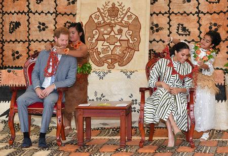 Meghan, Duchess of Sussex and Prince Harry, Duke of Sussex are given flower garlands at the Fa'onelua Convention Centre on the second day of the royal couple's visit to Tonga, October 26, 2018. Dominic Lipinski/Pool via REUTERS