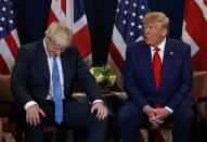 FILE - In this Tuesday, Sept. 24, 2019 file photo President Donald Trump meets with British Prime Minister Boris Johnson at the United Nations General Assembly, in New York. British Prime Minister Boris Johnson has said a lot of nice things about Donald Trump over the years, from expressing admiration for the U.S. president to suggesting he might be worthy of the Nobel Peace Prize. But after a mob of Trump supporters invaded the U.S. Capitol on Jan. 6, Johnson has changed his tune.(AP Photo/Evan Vucci, File)