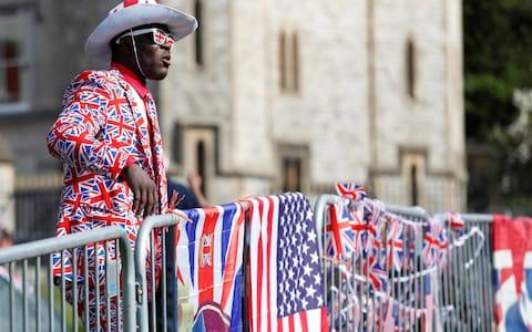A royal fan waits behind barriers on The Long Walk leading to Windsor Castle  - Credit: DAMIR SAGOLJ /Reuters