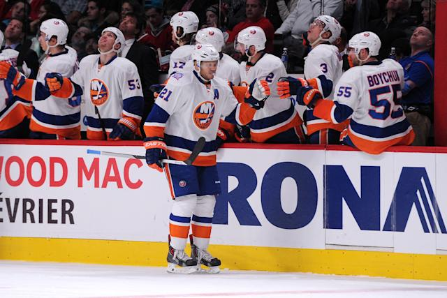 MONTREAL, QC - JANUARY 17: Kyle Okposo #21 of the New York Islanders celebrates his second period goal with teammates during the NHL game against the Montreal Canadiens at the Bell Centre on January 17, 2015 in Montreal, Quebec, Canada. (Photo by Richard Wolowicz/Getty Images)