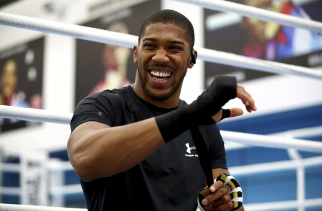 British boxer Anthony Joshua laughs, prior to a media session at the English institute of Sport, in Sheffield, England, Wednesday May 1, 2019. Andy Ruiz Jr. will look to become Mexicos first heavyweight champion after replacing Jarrell Miller as the opponent for unbeaten WBA, IBF and WBO titleholder Anthony Joshua. (Dave Thompson/PA via AP)