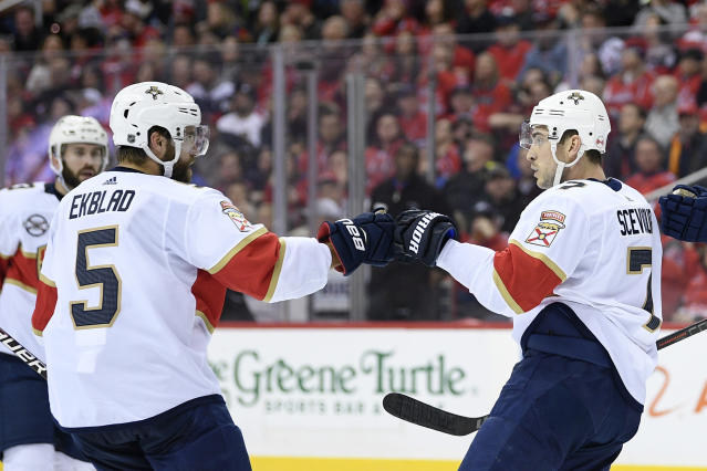 Florida Panthers center Colton Sceviour (7) celebrates his goal with defenseman Aaron Ekblad (5) during the second period of an NHL hockey game against the Washington Capitals, Saturday, Feb. 9, 2019, in Washington. (AP Photo/Nick Wass)