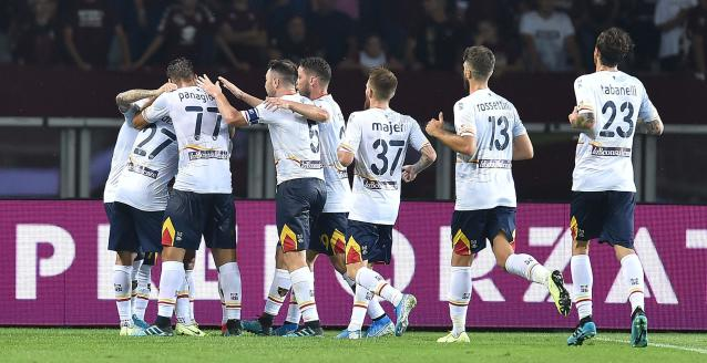 Lecce's Diego Farias, left, jubilates with his teammates after scoring during the Italian Serie A soccer match between Torino FC and US Lecce at the Olimpico Grande Torino stadium in Turin, Italy, Monday Sept. 16, 2019. (Alessandro Di Marco/ANSA via AP)