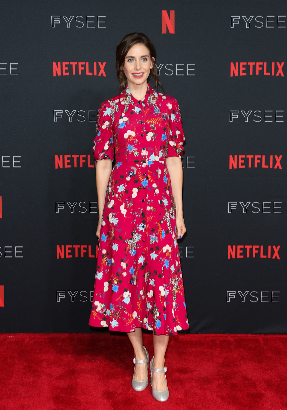 <p>Alison Brie donned a floral dress by Erdem accessorised with a pair of Sophia Webster shoes. <em>[Photo: Getty]</em> </p>