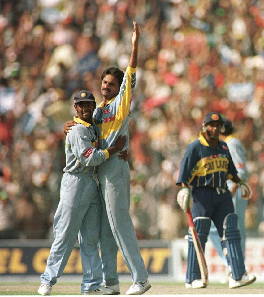 13 Mar 1996:  Javagal Srinath of India is congratulated by teammate Vinod Kambli after taking the wicket of Gurusinghe of Sri Lanka during the semifinal of the Cricket World Cup played at Eden Gardens in Calcutta, India. Mandatory Credit: Ross Kinnaird/Allsport