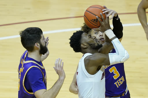 Indiana's Al Durham (1) goes to the basket against Tennessee Tech's Shandon Goldman, left, and Keishawn Davidson during the second half of an NCAA college basketball game, Wednesday, Nov. 25, 2020, in Bloomington, Ind. (AP Photo/Darron Cummings)