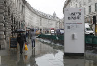 A large sign to thank people for coming to London's West End and to stay safe by observing social distancing to help stop the spread of the coronavirus in London, Thursday, Oct. 29, 2020. Around 100,000 people are catching the coronavirus every day in England, according to the latest Imperial College London study. (AP Photo/Alastair Grant)