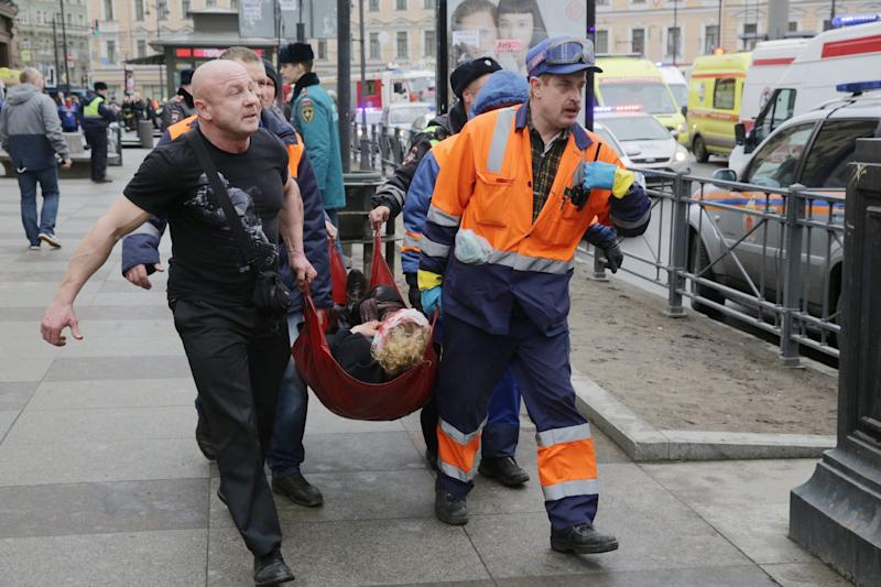 Russian rescuers carry a victim of an explosion at Tekhnologichesky Institute metro station in Saint Petersburg - Credit: ANTON VAGANOV/EPA