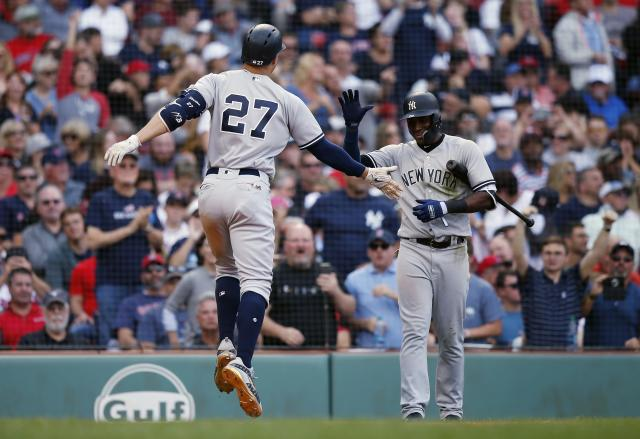 New York Yankees' Giancarlo Stanton (27) celebrates his solo home run with Adeiny Hechavarria during the seventh inning of a baseball game against the Boston Red Sox in Boston, Saturday, Sept. 29, 2018. (AP Photo/Michael Dwyer)