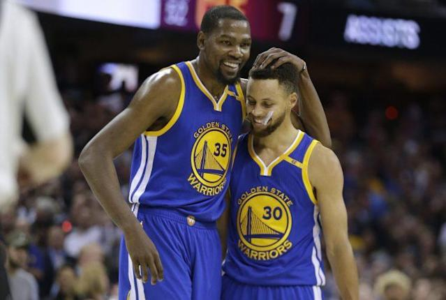 "Are <a class=""link rapid-noclick-resp"" href=""/nba/players/4244/"" data-ylk=""slk:Kevin Durant"">Kevin Durant</a> and <a class=""link rapid-noclick-resp"" href=""/nba/players/4612/"" data-ylk=""slk:Stephen Curry"">Stephen Curry</a> going to leave in free agency? No, don't be silly. (AP)"