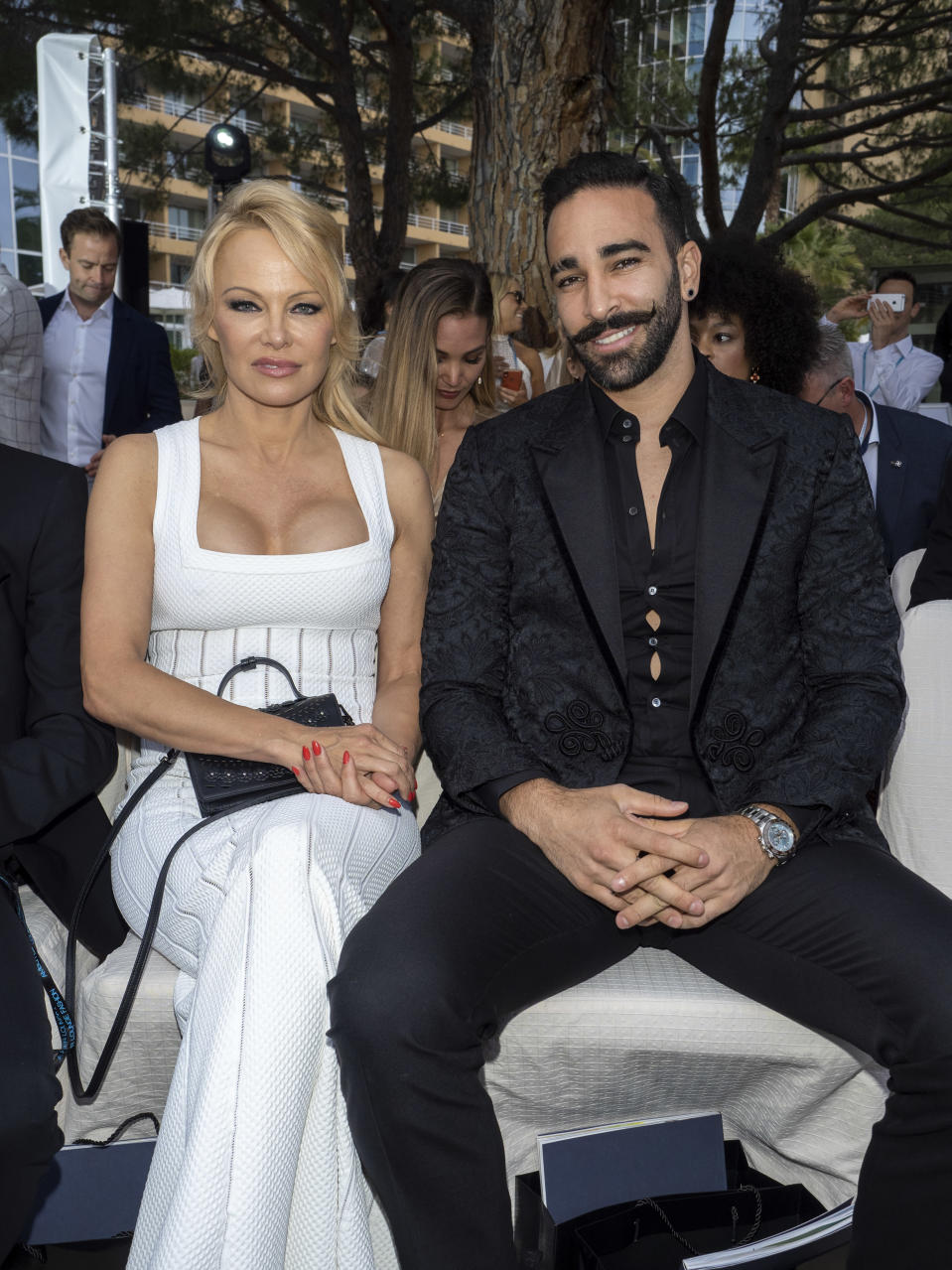 Pamela Anderson and Adil Rami at a fashion show in Monaco on May 24. (Photo: Arnold Jerocki/Getty Images)