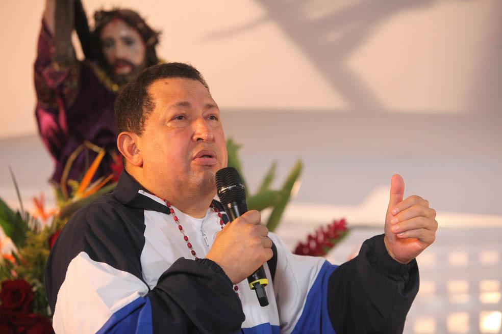 In this photo released by Miraflores Press Office, Venezuela's President Hugo Chavez delivers a speech as he attends a mass in Barinas, Venezuela, Thursday, April 5, 2012. Chavez, who attended the mass accompanied by relatives Thursday after returning from his latest round of radiation therapy treatment in Cuba, vowed to overcome cancer and to run for re-election in October. (AP Photo/Francisco Batista/Miraflores Press Office)