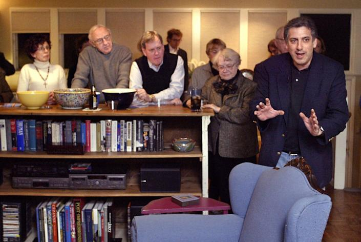 Howard Dean campaign manager Joe Trippi, right, makes a campaign stop in Des Moines, Iowa, on Jan. 5, 2004.