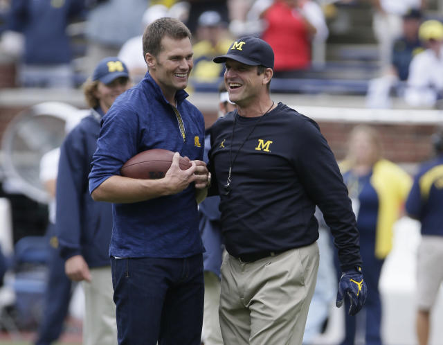 "<a class=""link rapid-noclick-resp"" href=""/nfl/players/5228/"" data-ylk=""slk:Tom Brady"">Tom Brady</a> had to pay up a bet on the Ohio State game thanks to Jim Harbaugh (right) and Michigan. (Photo by Duane Burleson/Getty Images)"