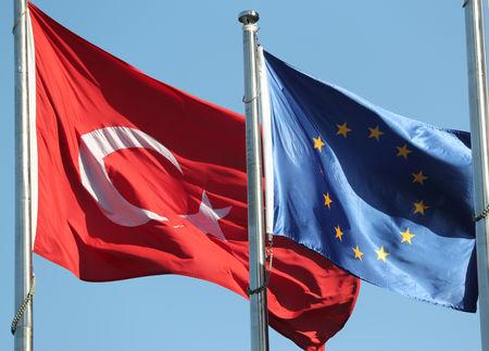 European Union and Turkish flags fly at the business and financial district of Levent in Istanbul