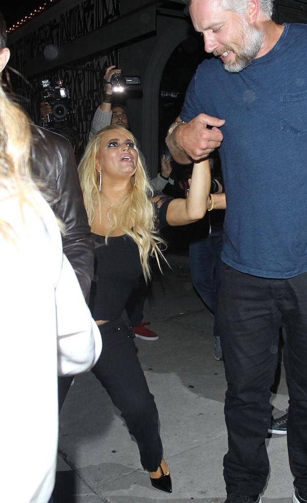 Jessica Simpson is helped into her car by Eric Johnson after leaving Craig's restaurant in West Hollywood on Sept. 20 after a six-hour dinner with friends.