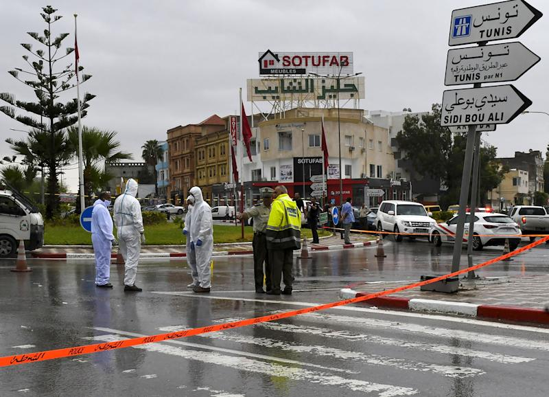 """Tunisian forensic police investigate the site of an attack on Tunisian National Guard officers on September 6, 2020, in Sousse, south of the capital Tunis. - Attackers with knives killed a Tunisian National Guard officer and wounded another before three assailants were shot dead in a firefight, the security force said, labelling it a """"terrorist attack"""". The attack took place in the tourist district of the coastal city of Sousse, the site of the worst of several jihadist attacks in recent years, where 38 people, most of them Britons, were killed in a 2015 beachside shooting rampage. (Photo by Bechir TAIEB / AFP) (Photo by BECHIR TAIEB/AFP via Getty Images)"""