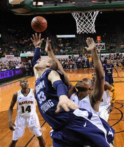 Brigham Young's Nate Austin (33) reaches for a rebound with Baylor's Rico Gathers, right, in the first half of an NCAAcollege basketball game, Friday, Dec. 21, 2012, in Waco, Texas. (AP Photo/Waco Tribune Herald, Rod Aydelotte)