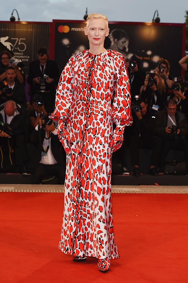 <p>Tilda's red, animal print Schiaparelli look – complete with gloves and matching heels – certainly stood out. <em>[Photo: Getty]</em> </p>
