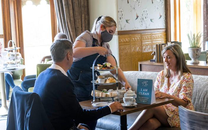 Guests at Studley Castle Hotel in Warwickshire eat at the Evesham restaurant as Warner Leisure hotel group re-opens all 14 of its properties in England and Wales today - Fabio De Paola/PA