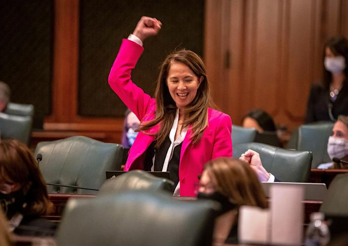Illinois State Rep. Jennifer Gong-Gershowitz, D-Glenview, celebrates the passage of House Bill 367 on the floor of the Illinois House of Representatives in Springfield, Ill., on May 31, 2021.