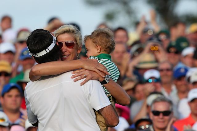 AUGUSTA, GA - APRIL 13: Bubba Watson of the United States celebrates with his wife Angie and their son Caleb on the 18th green after winning the 2014 Masters Tournament by a three-stroke margin at Augusta National Golf Club on April 13, 2014 in Augusta, Georgia. (Photo by Andrew Redington/Getty Images)