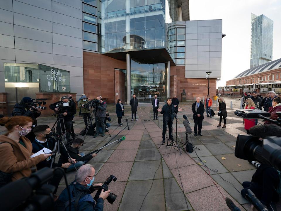 Greater Manchester mayor Andy Burnham speaks to the media outside Bridgewater Hall, following last-ditch talks with the Prime Minister aimed at securing additional financial support for his consent on new coronavirus restrictions, in Manchester (AP)