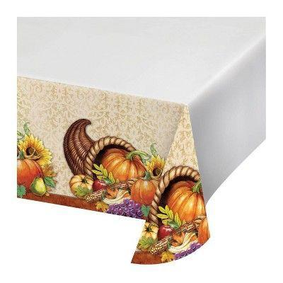 """<p><strong>Creative Converting</strong></p><p>target.com</p><p><strong>$22.99</strong></p><p><a href=""""https://www.target.com/p/3ct-harvest-thanksgiving-plastic-tablecloth/-/A-78593676"""" rel=""""nofollow noopener"""" target=""""_blank"""" data-ylk=""""slk:Shop Now"""" class=""""link rapid-noclick-resp"""">Shop Now</a></p><p>This simple tablecloth has printed edges depicting an overflowing cornucopia. </p>"""