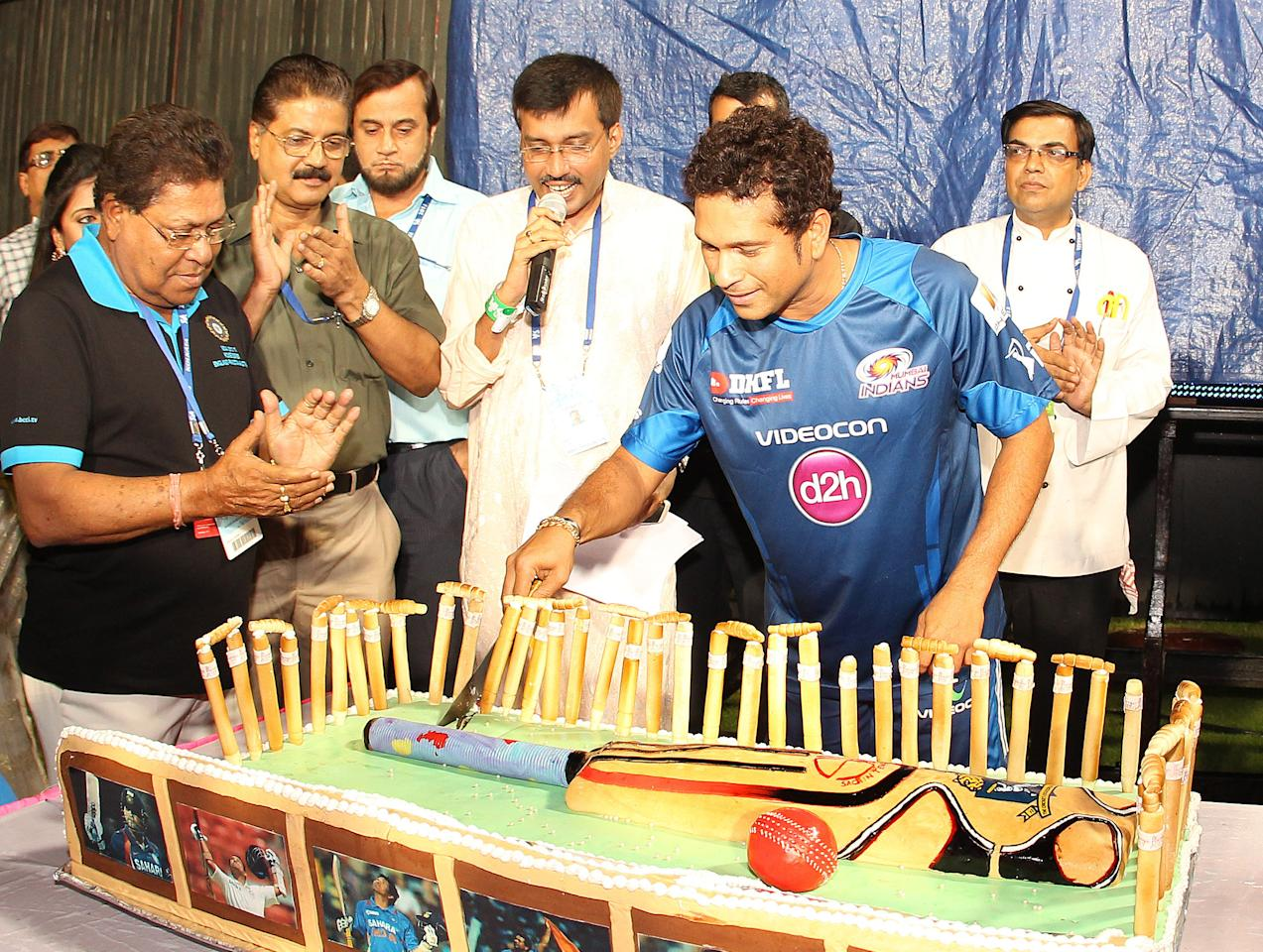 Sachin Tendulkar is presented with a cake to commemorate his 40th birthday during match 33 of the Pepsi Indian Premier League between The Kolkata Knight Riders and the Mumbai Indians held at the Eden Gardens Stadium in Kolkata on the 24th April 2013..Photo by Ron Gaunt-IPL-SPORTZPICS  ..Use of this image is subject to the terms and conditions as outlined by the BCCI. These terms can be found by following this link:..https://ec.yimg.com/ec?url=http%3a%2f%2fwww.sportzpics.co.za%2fimage%2fI0000SoRagM2cIEc&t=1490308176&sig=ps4OozfRf_Dp69WeuAuK9Q--~C