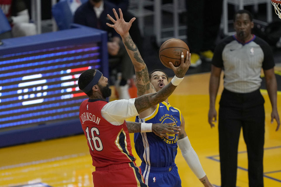 New Orleans Pelicans forward James Johnson (16) drives to the basket against Golden State Warriors forward Juan Toscano-Anderson (95) during the first half of an NBA basketball game on Friday, May 14, 2021, in San Francisco. (AP Photo/Tony Avelar)