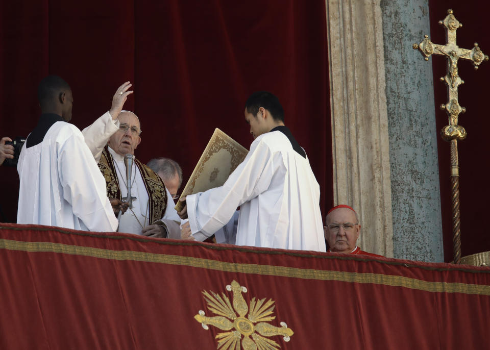 Pope Francis delivers the Urbi et Orbi (Latin for 'to the city and to the world' ) Christmas' day blessing from the main balcony of St. Peter's Basilica at the Vatican, Tuesday, Dec. 25, 2018. (AP Photo/Alessandra Tarantino)