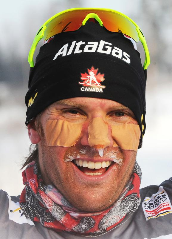 Devon Kershaw of Canada celebrates his victory at the FIS World Cup Cross-country men 15 km free mass start competition in Rybinsk, on February 4, 2012. AFP PHOTO / NATALIA KOLESNIKOVA