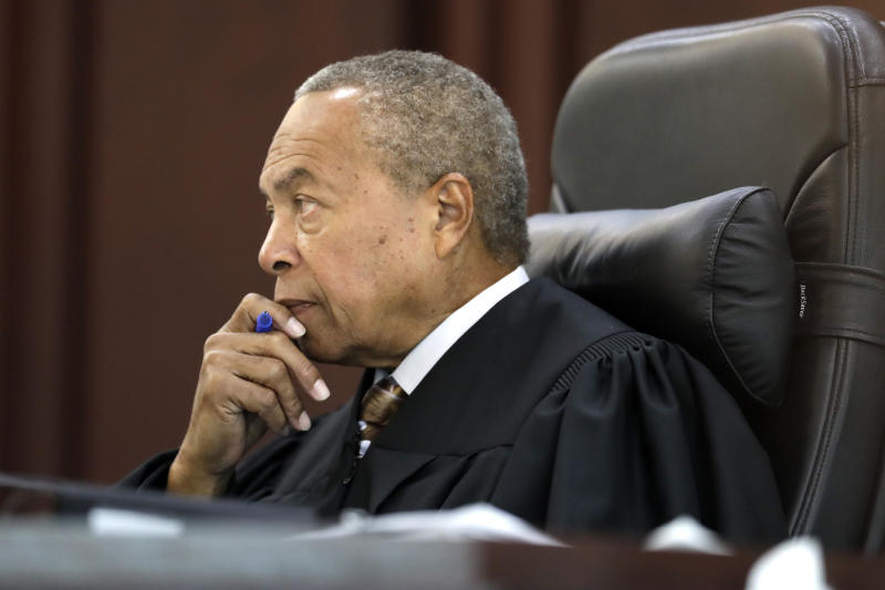 Judge Monte Watkins listens during a hearing for death row inmate Abu-Ali Abdur'Rahman Wednesday, Aug. 28, 2019, in Nashville, Tenn. Abdur'Rahman, who was convicted of murder and is scheduled to be executed next April, claims that prosecutors' racially motivated dismissal of potential black jurors resulted in an unfair trial. A court order presented at the hearing will convert Abdur'Rahman's death sentence to a sentence of life in prison if approved by Watkins. (AP Photo/Mark Humphrey)