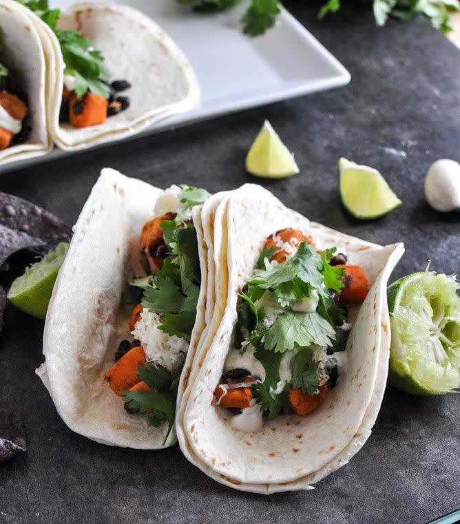 "<strong>Get the recipe for <a href=""http://www.howsweeteats.com/2012/12/embarrassingly-easy-smoky-sweet-potato-and-black-bean-tacos/"" rel=""nofollow noopener"" target=""_blank"" data-ylk=""slk:smoky sweet potato and black bean tacos"" class=""link rapid-noclick-resp"">smoky sweet potato and black bean tacos</a> by How Sweet Eats.</strong>"